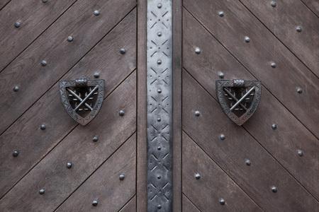 doorknocker: Doorknockers on the wooden gate fixed with rivets in Kokorin Castle in Central Bohemia, Czech Republic.