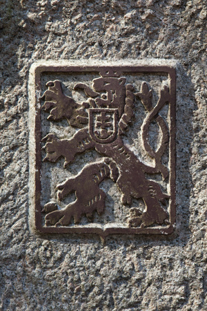 sudetes: Coat of arms of Czechoslovakia depicted on the Czech-German border in the Lusatian Mountains, North Bohemia, Czech Republic.