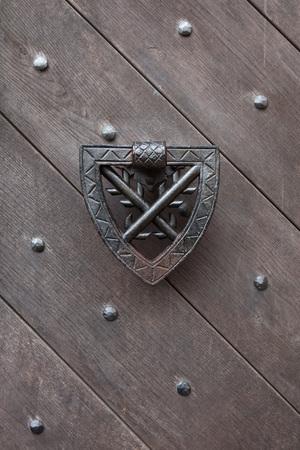 doorknocker: Doorknocker on the wooden gate fixed with rivets in Kokorin Castle in Central Bohemia, Czech Republic. Stock Photo