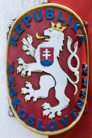 czechoslovak: Coat of arms of Czechoslovakia depicted on the Czech-German border in the Lusatian Mountains, North Bohemia, Czech Republic.