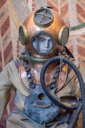 atmospheric pressure: BIARRITZ, FRANCE - JUNE 27, 2016: Old atmospheric diving suit from the 1910s displayed in the Musee de la Mer (Museum of the Sea) in Biarritz, France.