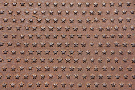 five star: Rusted iron cast panel covered with five-pointed stars pattern. Background texture. Stock Photo