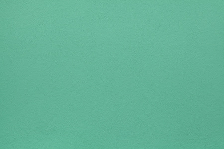 Green painted stucco wall. Background texture. Stock Photo