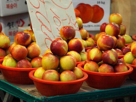 peach at market stall