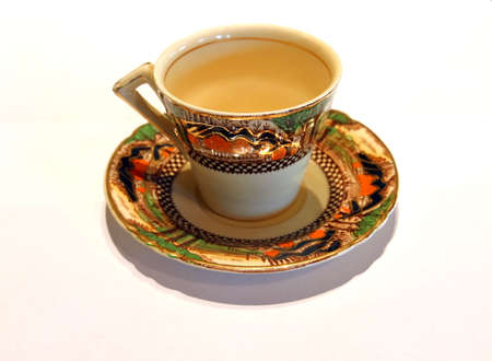 An antique cup and sucer in bone china Stock Photo