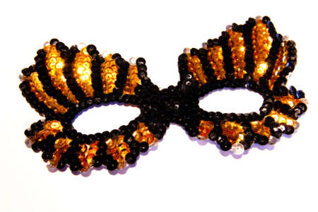 Party mask in black and gold sequins