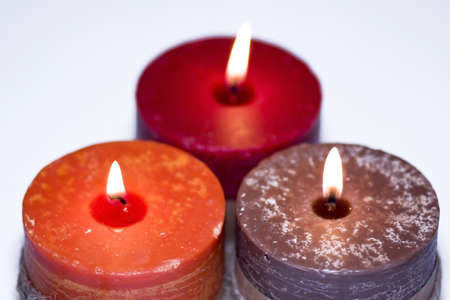 Three colorful burning candles