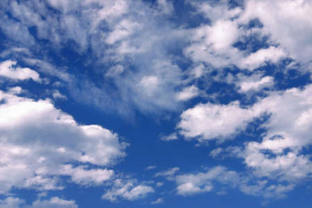 Bright Blue Sky and Clouds Stock Photo