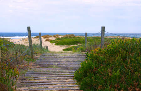 Shore conservation area and sand preserving walkway Stock Photo