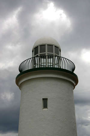 White Lighthouse with storm clouds