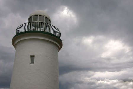 Lighthouse with stormy background Stock Photo