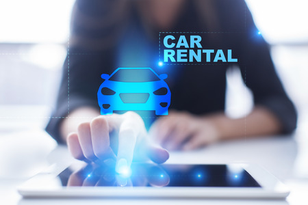 Womans hands pressing on tablet pc screen and select Car Rental. Stock Photo