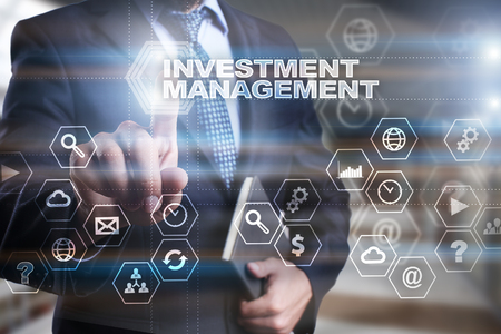rate of return: Businessman is pressing on the virtual screen and selecting Investment management.