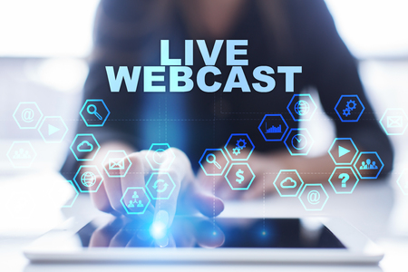live stream tv: Woman is using tablet pc, pressing on virtual screen and selecting live webcast Stock Photo