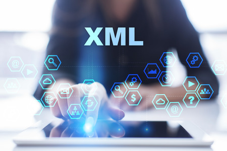 xml: Woman is using tablet pc, pressing on virtual screen and selecting xml Stock Photo