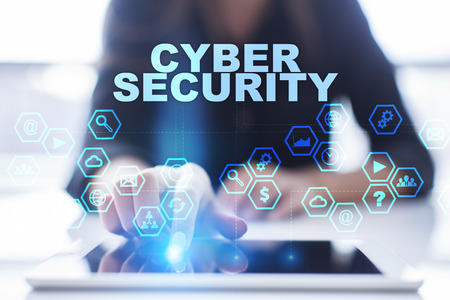 cyber defence: Woman is using tablet pc, pressing on virtual screen and selecting cyber security Stock Photo