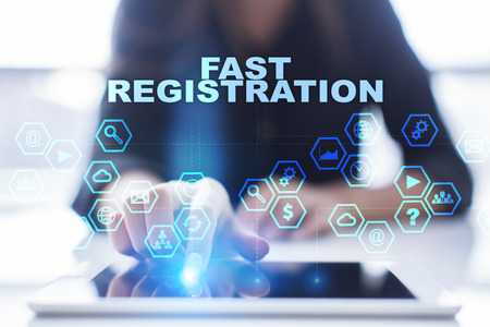 Woman is using tablet pc, pressing on virtual screen and selecting fast registration Stock Photo