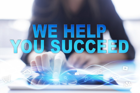 succeed: Woman is using tablet pc, pressing on virtual screen and selecting We help you succeed. Stock Photo
