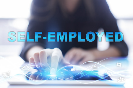 selfemployed: Woman is using modern tablet pc, presssing on touch screen and selecting Self-employed. Stock Photo