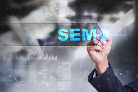 adwords: Business is drawing on virtual screen. sem concept.