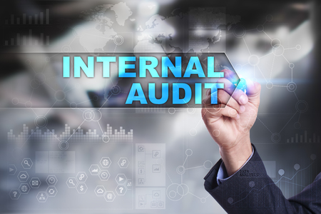 internal audit: Business is drawing on virtual screen. internal audit concept. Stock Photo