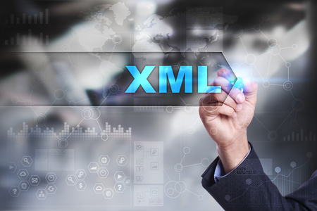 xml: Business is drawing on virtual screen. xml concept. Stock Photo