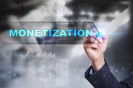 monetization: Business is drawing on virtual screen. monetization concept.