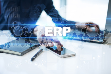 erp: Businessman is working in office, pressing button on virtual screen and selecting erp. Stock Photo