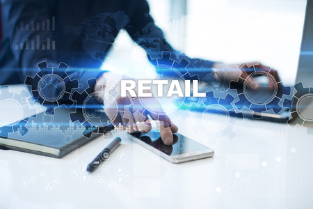 Businessman is working in office, pressing button on virtual screen and selecting retail. Stock Photo