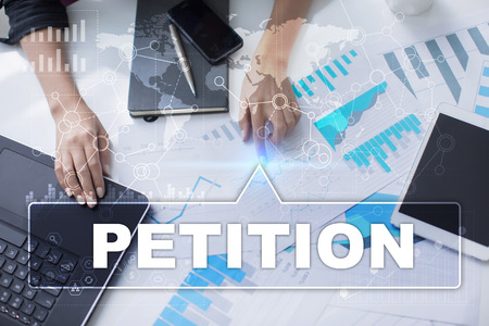 petitions: Woman is working with documents, tablet pc and notebook and selecting petition. Stock Photo