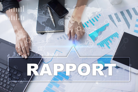 rapport: Woman is working with documents, tablet pc and notebook and selecting rapport.