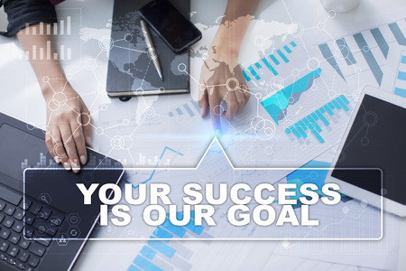 our: Woman is working with documents, tablet pc and notebook and selecting your success is our goal.