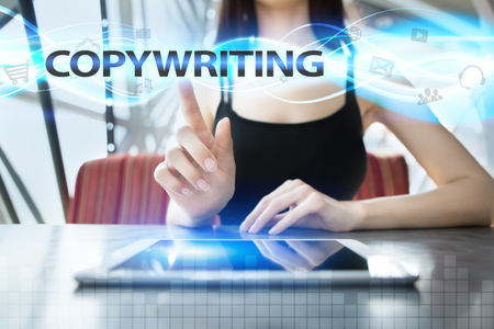 copywriting: Woman is using tablet pc, pressing on virtual screen and selecting copywriting Stock Photo