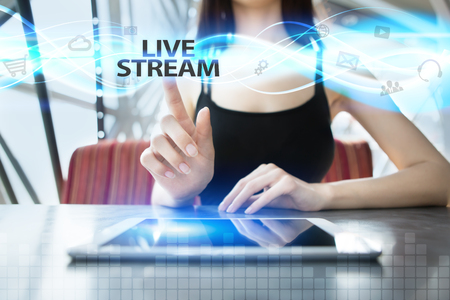 livestream: Woman is using tablet pc, pressing on virtual screen and selecting live stream