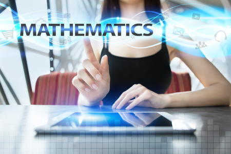 Woman is using tablet pc, pressing on virtual screen and selecting mathematics Stock Photo