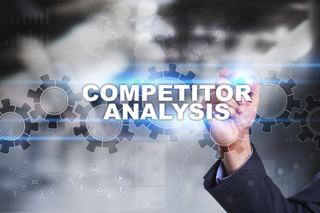 competitor: Businessman is drawing on virtual screen. competitor analysis concept.