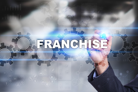 franchising: Businessman is drawing on virtual screen. franchise concept. Stock Photo
