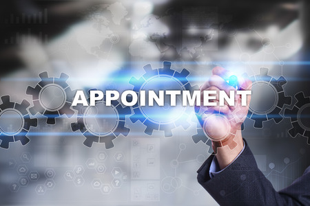 appointment: Businessman is drawing on virtual screen. appointment concept. Stock Photo