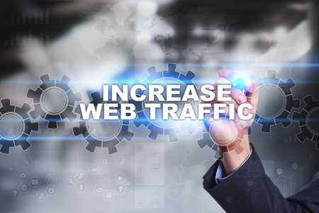 web traffic: Businessman is drawing on virtual screen. increase web traffic concept.