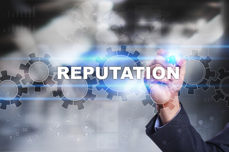 reputable: Businessman is drawing on virtual screen. reputation concept.