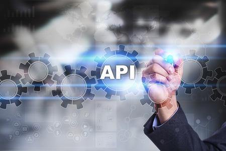 api: Businessman is drawing on virtual screen. api concept.