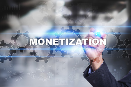 profiting: Businessman is drawing on virtual screen. monetization concept.