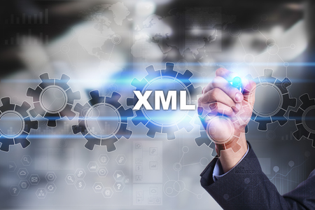 xml: Businessman is drawing on virtual screen. xml concept.