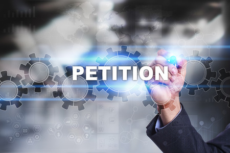 petitions: Businessman is drawing on virtual screen. petition concept.