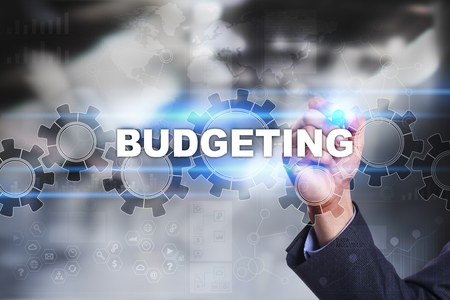 budgeting: Businessman is drawing on virtual screen. budgeting concept.