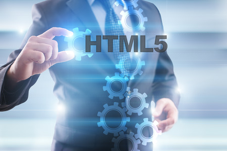 html5: Businessman selecting html5 on virtual screen. Stock Photo