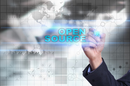 open source: Businessman is drawing on virtual screen. open source concept.
