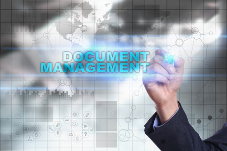 document management: Businessman is drawing on virtual screen. document management concept. Stock Photo