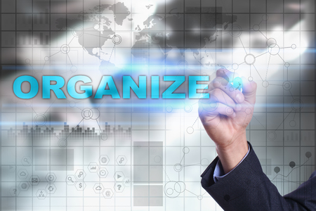 organize: Businessman is drawing on virtual screen. organize concept. Stock Photo