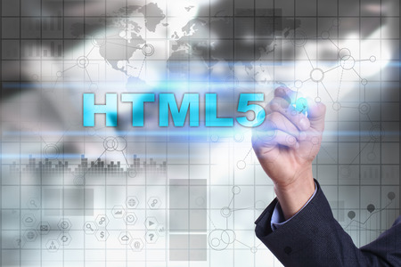 html5: Businessman is drawing on virtual screen. html5 concept.